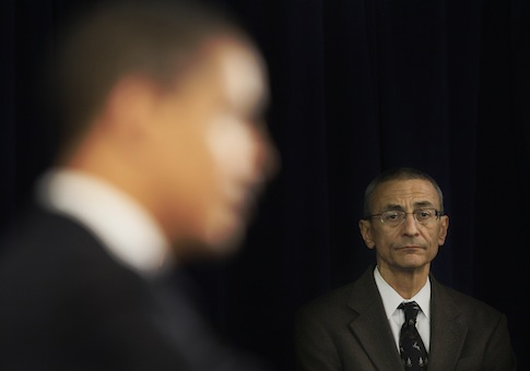 John Podesta listens as Obama answers questions at a news conference / AP