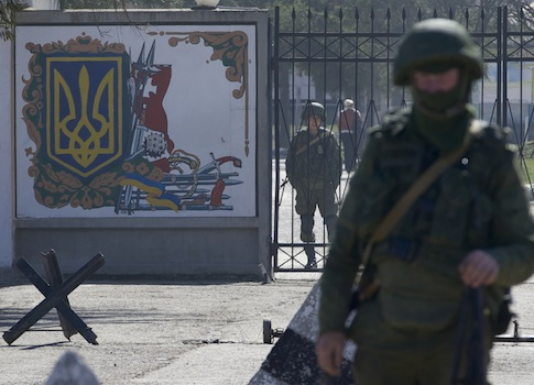 Russian soldiers guard the entrance to the Ukrainian military base in Perevalne, Crimea / AP