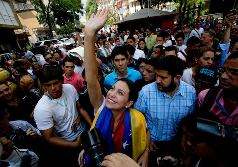 Maria Corina Machado greets supporters upon her arrival for a rally in Caracas / AP