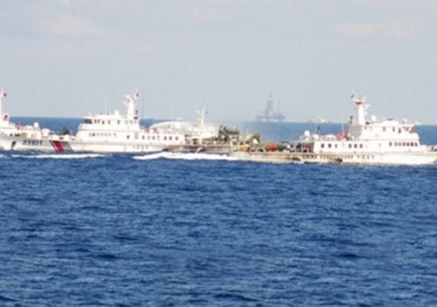 Chinese maritime patrol ships block a Vietnamese vessel near a Chinese oil rig in South China Sea