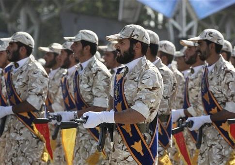 Members of Iran's Revolutionary Guard march