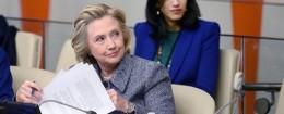 Huma Abedin sits close behind Hillary Clinton
