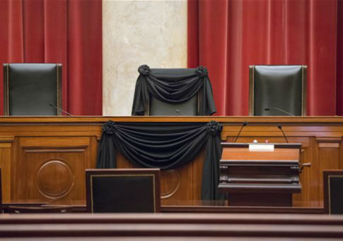 Supreme Court Justice Antonin Scalia's courtroom chair is draped in black to mark his death / AP