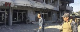 Iraqi security forces inspect damaged buildings after clashes with ISIS terrorists in Kirkuk / AP