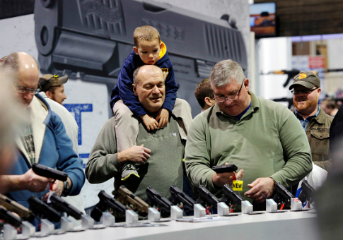 Visitors view a gun display at a NRA outdoor sports trade show in Harrisburg, Penn. / Getty Images