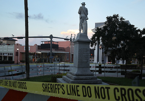 Barricades surround the Confederate monument in front of the Hernando County Courthouse to keep possible protesters away from the statue in the midst of a national controversy over whether Confederate symbols should be removed from public display on August 19, 2017 in Brooksville, Florida. The issue is at the heart of a debate about race in America and a recent protest in Charlottesville, VA turned deadly as white-supremacists clashed with counter-demonstrators over a confederate statue. / Getty Images