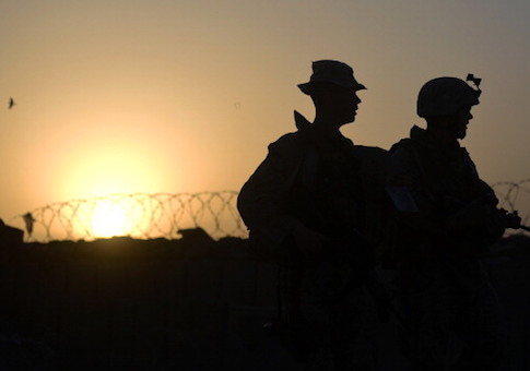US Marines from 1st Battalion 7th Marines Regiment walk at dusk in Afghanistan