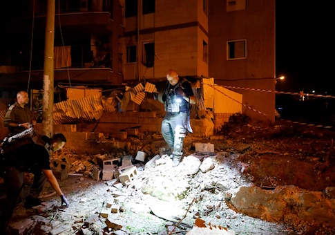 Israeli emergency personnel gather at the site of rocket attack in the southern Israeli town of Ashdod