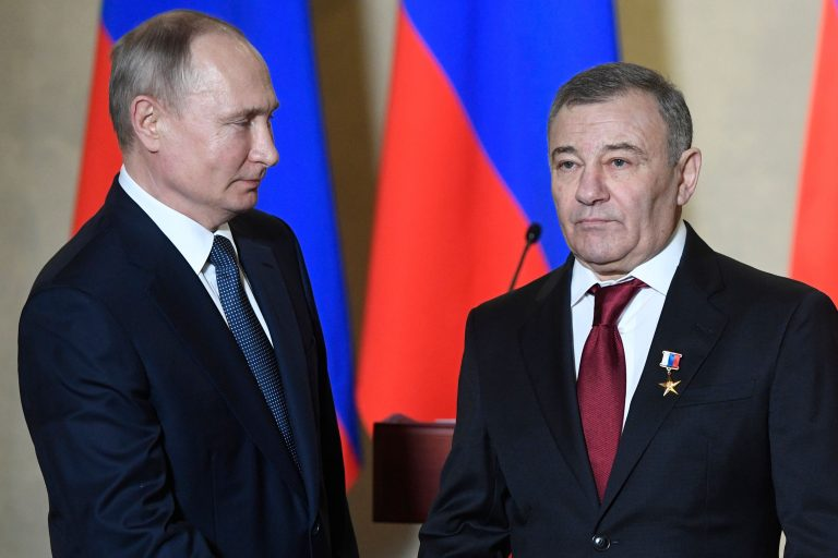 Russian President Vladimir Putin decorates businessman Arkady Rotenberg with the Hero of Labour medal